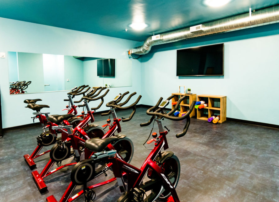 Speed bike spin room in apartments designed by Think Architecture