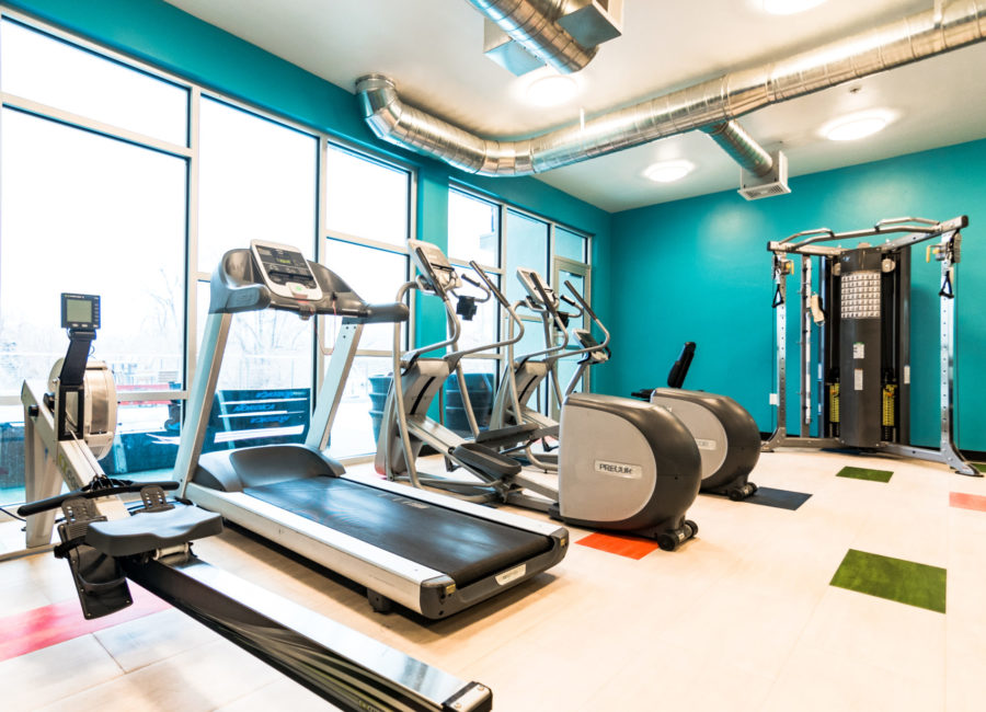 treadmills in gym - interior designs by Think Architecture