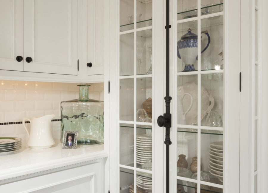 Kitchen glass cabinet inside pantry in custom designed home